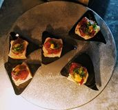 Small tune poke appetizer on Crackers catering royalty free stock images