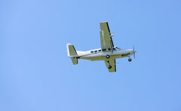 Small turboprop airplane. In flight Stock Photography