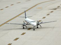 Small turboprop airplane on runway. Saab regional turboprop for charter in caribbean islands Stock Image