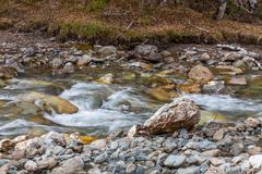 Small but turbulent mountain river Small Yaloman in Altai, Russia.  stock photos