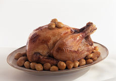 Small turkey stuffed with chestnuts and grapes Stock Photography