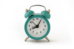 Small turquoise clock - eight hours. On white  background Royalty Free Stock Photo