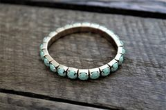 Small Turquoise and Gold Bracelet Jewelry Royalty Free Stock Images