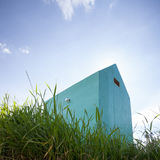Small turquoise hut in grass Stock Photos