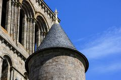 Small Turret. A small stone and tiled turret with a golden decoration on top Stock Image