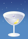 Small turtle swimming in a cocktail glass under stars Stock Image