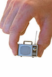 Small TV. A hand holding a small TV on White Stock Image