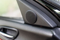 Small tweeter speaker on car door. Small tweeter speaker on sport car door Stock Images