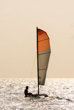 Small twin hull sailing boat on calm ocean. Stock Images