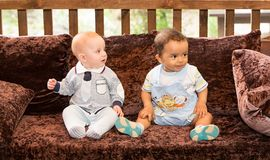 Small two children: black american and caucasian boys Stock Image