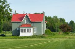 Farmhouse with red roof Royalty Free Stock Image