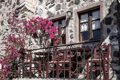Small typical terrace with flowers at the house in Pyrgos Stock Photography