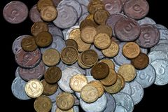 Small Ukrainian coins isolated on black background. Close-up royalty free stock photography
