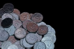 Small Ukrainian coins isolated on black background. Close-up stock photos