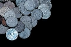 Small Ukrainian coins isolated on black background. Close-up view. royalty free stock images