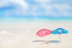 Small umbrellas on tropical beach. Two small colorful umbrellas on tropical beach Stock Photos