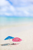 Small umbrellas on tropical beach. Two small colorful umbrellas on tropical beach Stock Photography