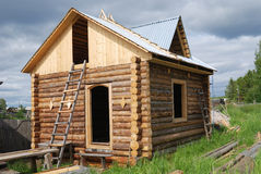 Small unfinished wooden timber home Royalty Free Stock Photos