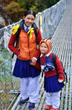 Small unidentified children go home from school in Phakding, Nepal Royalty Free Stock Photo