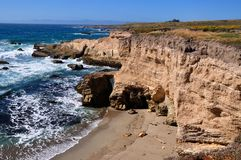 Small unspoilt beach and cliff in California central coast. Montana de oro state park, USA Royalty Free Stock Photo