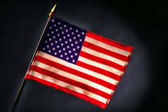 Small US American Flag on Smoky Black Background. Small miniature US American flag on smoky black background Royalty Free Stock Images