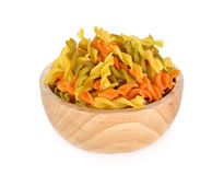 Small vegeroni Rotini spirals pasta in wooden bowl on white back. Small vegeroni Rotini spirals pasta in wooden bowl on a white background stock images