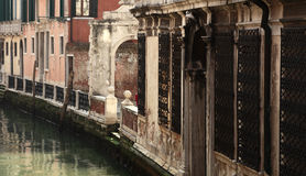 Small Venetian canal. Image of the walls of houses near the water on a small canal in Venice Stock Images