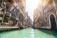 Small venetian canal and old brick walls with vintage traditiona Royalty Free Stock Images