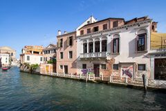 Small venetian canal, Venice, Italy. Small venetian canal and old brick houses in Venice, Italy Royalty Free Stock Image