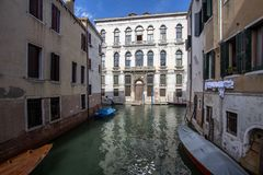 Small venetian canal, Venice, Italy. Small venetian canal and old brick houses in Venice, Italy Royalty Free Stock Photo