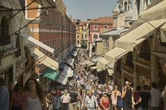The road full of tourists. Small Venetian street seen from the riot bridge crowded with visiting people Royalty Free Stock Photos