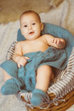 Small very cute smiling baby girl lying in basket Royalty Free Stock Photos