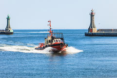 Small vessel returning to port. Royalty Free Stock Photography