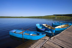 Small vessels arranged together in a lake, in the fall. North china Royalty Free Stock Image