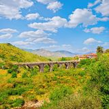 Small viaduct in the mountain valley. Stock Photo