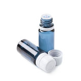 Small vial flask. Small blue glass flask vial, composition  over the white background Stock Images