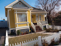 Small Victorian style house. The so called middle class home from the past. A white fence surrounds a  small piece of grass in front. Small house but a good roof Royalty Free Stock Photo