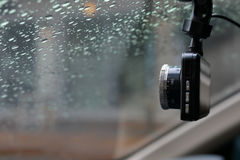 Small video camera record inside motor vehicle on windshield. Drive car road trips in rainny day weather Royalty Free Stock Images