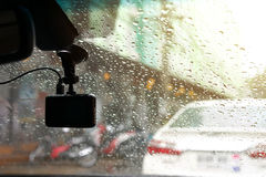 Small video camera record inside motor vehicle on windshield. Drive car road trips in rainny day weather Royalty Free Stock Image