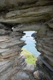 Small view of Coast through ancient  stone wal Stock Image