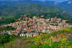 Small village. Typical Sicilian village in the countryside (italy) by a sunny day with vines at first plan Stock Photos