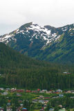 Small village... Carved out of the mountainside of Juneau, Alaska. With no roads into Juneau, someone said, There are only 3 ways to get here: plane, boat Royalty Free Stock Image