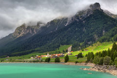 Small village and alpine lake in Switzerland. Stock Photography