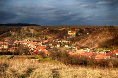 A small village before the autumn thunderstorm royalty free stock image