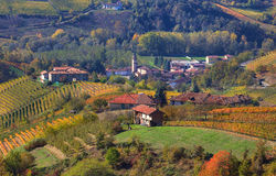 Small village and autumnal vineyards in Piedmont, Italy. Royalty Free Stock Photos