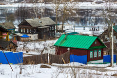 Small village on banks of river Volga, Russia. The small village on the banks of the river Volga, Russia Stock Photography