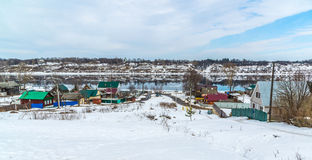Small village on banks of river Volga, Russia. The small village on the banks of the river Volga, Russia Stock Images