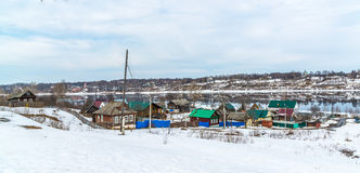 Small village on banks of river Volga, Russia. The small village on the banks of the river Volga, Russia Stock Photos
