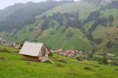 Small village at the base of the mountain. Cottage royalty free stock photo