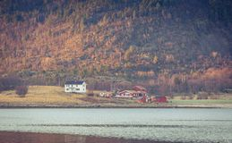 Small village at a base of a mountain. Small scandinavian fishing village at a base of a high mountain Royalty Free Stock Photos